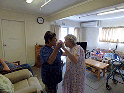 Rest home in Auckland - Staff member dancing with resident in lounge