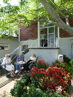 Rest home in Auckland - Women sitting around table in outdoor area